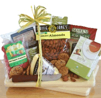 Organic Cheese and snacks on cutting board