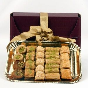 Baklava on gold tray in gift box