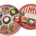 oreo cookies decorated for Christmas and packed in a holiday tin.