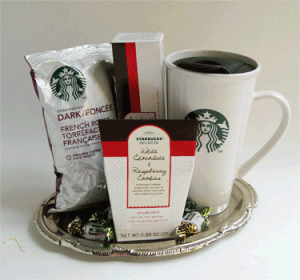Godiva coffee, travel mug, cookies and candy.