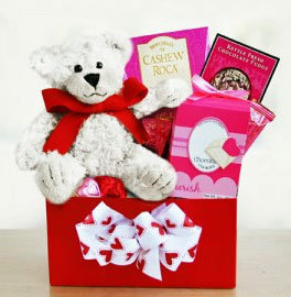 Valentine teddy bear with treats in gift box