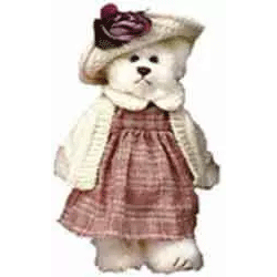 Girl bear dressed in dress, sweater, and hat